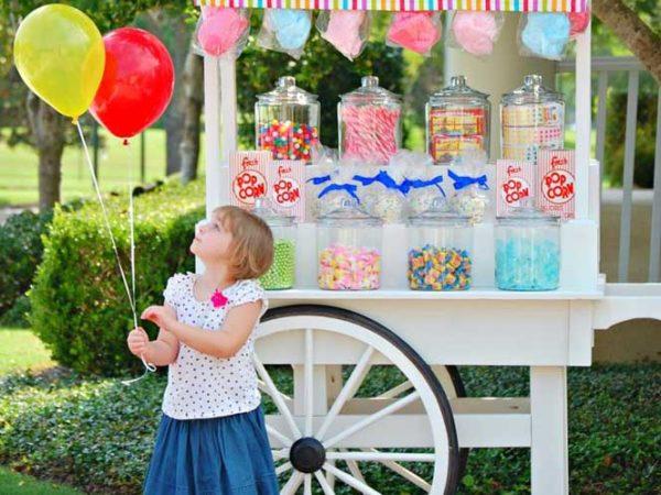 compleanno bambini con carretto dei dolci e pop corn